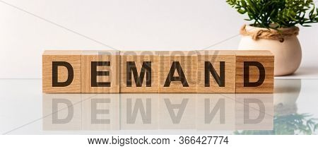 The Word Of Demand On Building Blocks Concept On The White Background.