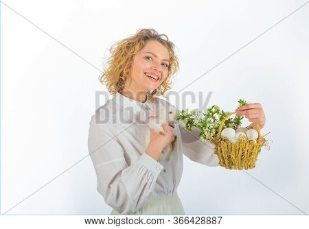Eggs Hunt. Smiling Woman Holds Basket With Eggs And Easter Bunny Rabbit. Basket With Eggs. Easter Eg