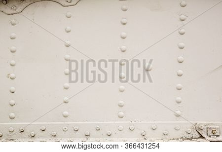 Old Silver Metal Surface Of The Aircraft Fuselage With Rivets. Iron Plate,steel Sheet Texture,patter