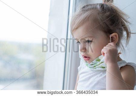 Concept: Self-isolation, Home Quarantine, Virus, Loneliness, Boredom, Protective Masks. Children Wea