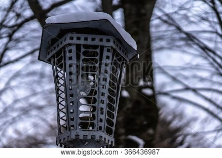 Lamppost With Snow On The Roof.lamppost With Snow On The Roof