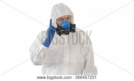 Doctor Wearing Hazard Suit Pointing With Finger Up Wanting Your Attention On White Background.