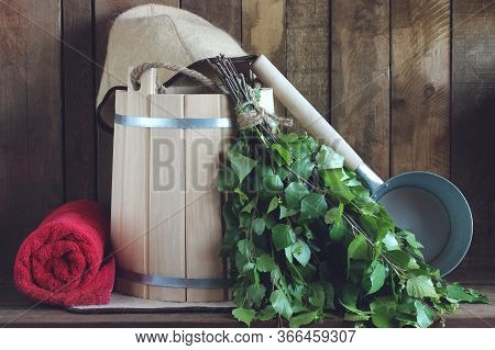 Birch Broom, A Wooden Bucket And A Towel For A Bath Or A Steam Room. Interior And Accessories.