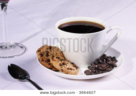 Coffee Cup With Biscuits And Coffee Beans