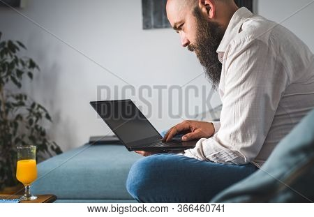 Man Working On Laptop From Home. Busy People Lifestyle. Man Typing On Laptop Computer. Work From Hom