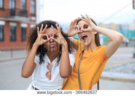 Two Young Smiling Hipster Women In Summer Clothes Posing On Street.female Showing Positive Face Emot