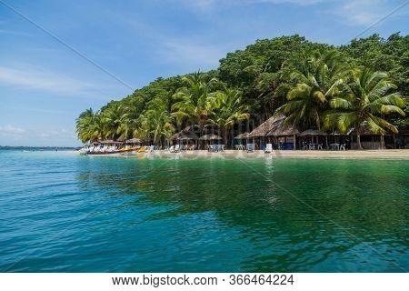 Bocas Del Toro, Panama: August 23, 2019: beautiful caribbean beach with boats, Bocas del Toro, Panama