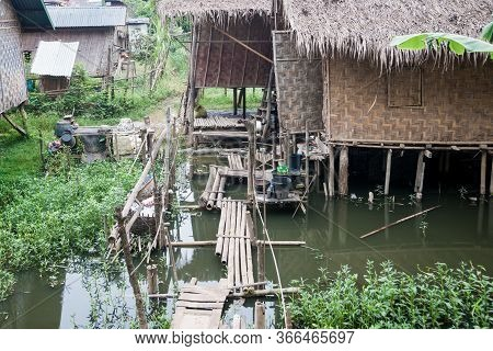 Myanmar Travel Images Homes Of Poor People Built Shack Like On Edge Of River Not For From City.