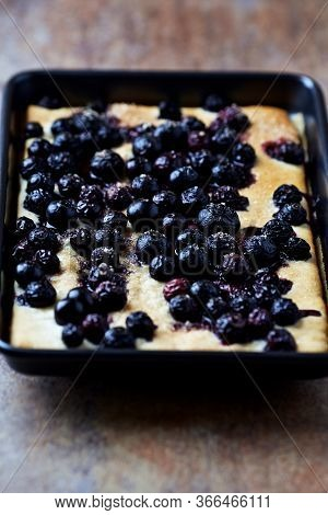 Homemade Blueberries Cake. Rustic Stone Background. Close Up.