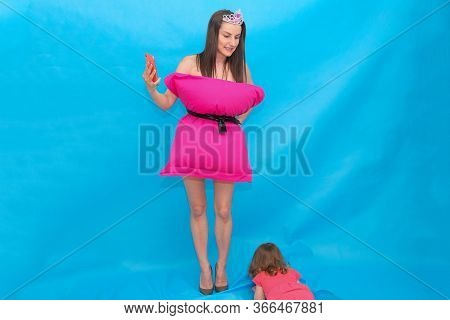 Woman In Pink Pillow Dress And Crown Take A Selfie Photo On A Mobile Phone For A Crazy Pillow Challe