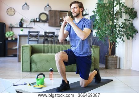 Handsome Man Doing Sport Exercise At Home During Quarantine. Concept Of Healthy Life.
