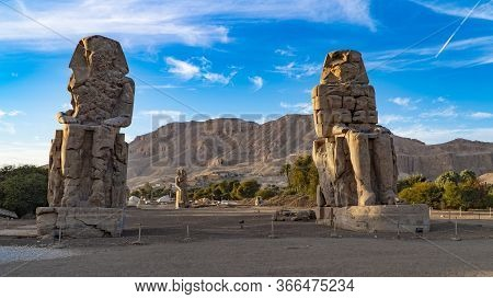 The Colossi Of Memnon, Two Stone Massive Statues Of The Pharaoh Amenhotep Iii, Who Reigned In Egypt