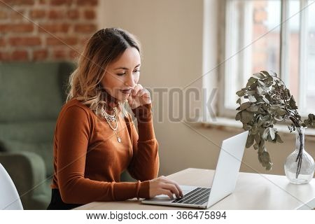 A Business Woman Who Has A Video Call With A Colleague Working Online From Home In A Cozy Atmosphere