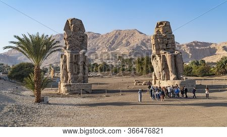 Luxor, Egypt - January 2020: The Colossi Of Memnon, Two Stone Massive Statues Of The Pharaoh Amenhot