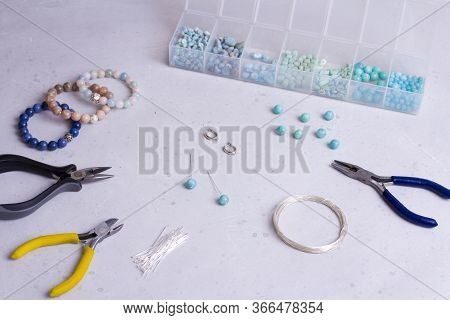 Making Of Handmade Jewellery. Top View. Beads, Tools For Creating Jewelry. Preparation For Handmade.