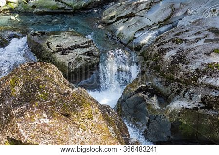 Fiordland. A Stormy Stream Disappearing Into A Funnel. Funnel Chasm. Stream Among Stones. New Zealan