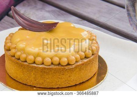 Shortcrust Pastry Tart With Hazelnut, Cream And Honey With Chocolate Decoration