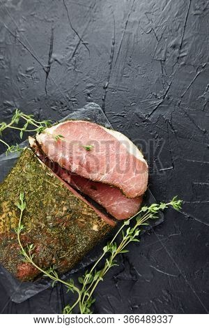 Polendwitz Is A Jerky Tenderloin, Dried Pork With Spices And Fresh Green Thyme, Slate Cutting Board