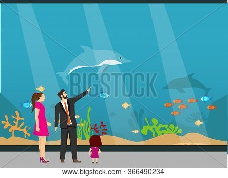 Oceanarium, A Young Family With Children Examines Fish In The Aquarium. The Underwater World Of The