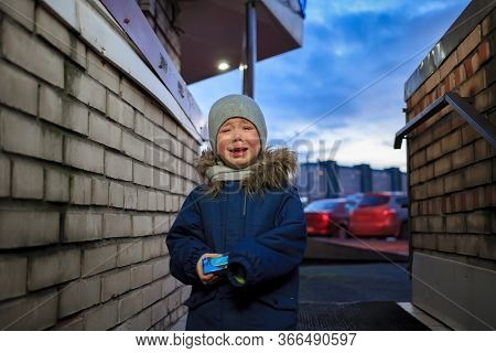 A Little Boy 3-4 Years Old Is Upset And Crying Against The Backdrop Of An Unattractive And Unfriendl