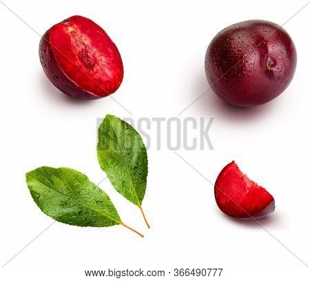 Plums From Different Angles And Leaves Isolated On White Background. Appetizing And Healthy Red Plum