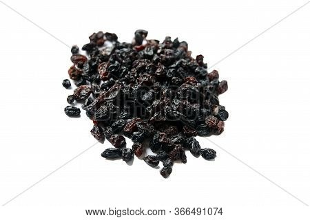Raisins Isolated On White Background. Heap Of Dried Red Grapes, Selective Focus