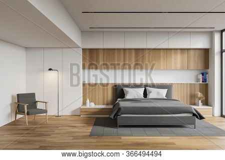 Interior Of Comfortable Master Bedroom With White And Wooden Walls, Wooden Floor, King Size Bed Stan