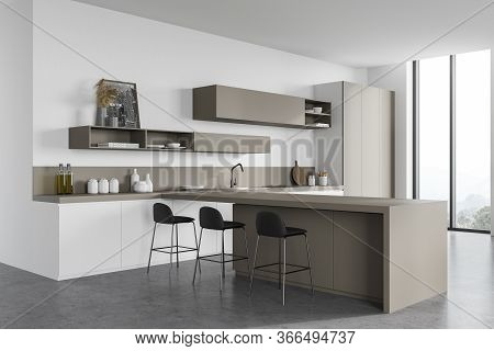 Corner Of Modern Kitchen With White Walls, Concrete Floor, Beige Cupboards, White Countertops And Ba