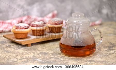 Kettle With Tea And Roses Buns, Sweet Buns With Sugar Powder.