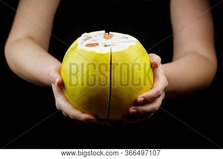 Pomelo Citrus Fruit With Sweet Red Flesh And Yellow Thick Rind On Black Background. Fresh Juicy Shad