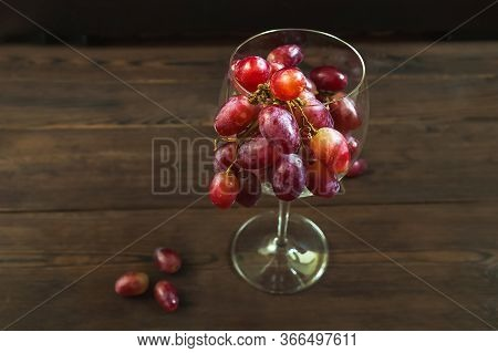 Juicy Large Bunch Of Grapes In A Wine Glass Close-up. Ripe Grapes And Copy Space. An Abundance Of Gr