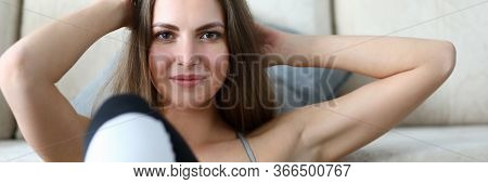 Girl Lies With Her Hands Behind Her Head, Exercise. Young Woman Does Exercises To Strengthen Abs, Ly