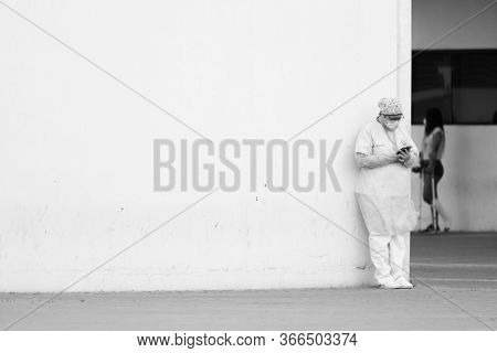 Health-center staff  at the emergency entrance of the hospital La Fe resting a few minutes during the state of alarm for the coronavirus crisis in Valencia, Spain on May 15, 2020.