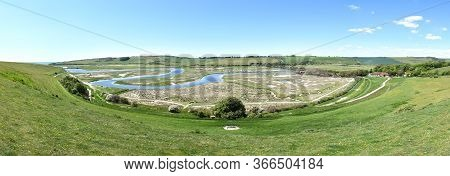Panoramic View Of The Estuary Of The River Cuckmere At Cuckmere Haven, Showing The Iconic Meandering