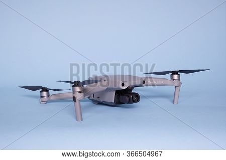 The Hague, The Netherlands - May 2020: New Dji Mavic Air 2 Model 2020 Drone On Blue Background Quadc