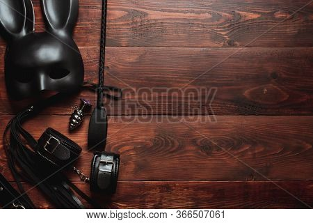 Set Of Erotic Toys For Bdsm Sex. Lash, Handcuffs, Leather Belt, Mask And A Plug