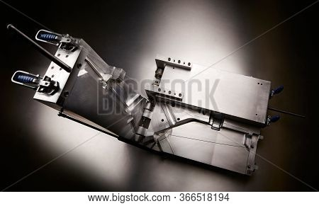 Top View Of A Injection Molding Die On Studio Background