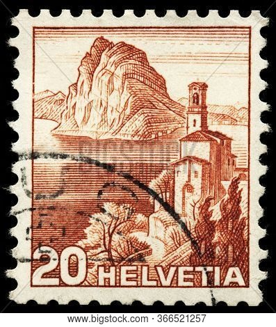 Luga, Russia - October 25, 2019: A Stamp Printed By Switzerland Shows Castagnola Church Against View