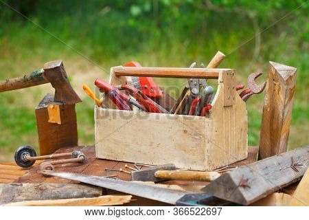 Wooden Toolbox With Different Vintage Worktools. Old Carpenter Toolbox With Tools On Wooden Table.