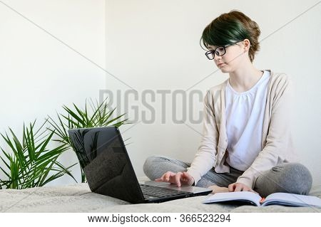Distance Learning Online Education. Teen Schoolgirl Studying At Home, Using Laptop. Caucasian Girl S