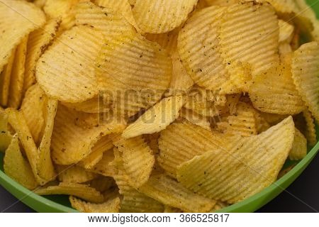Crispy Potato Chips In A Green Cup Close-up. Fried Crispy Chips