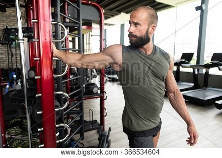Healthy Young Man Stretches In A Gym
