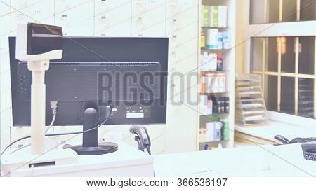 Cash Desk - Computer And Monitor In A Pharmacy. Interior Of Drug And Vitamins Shop. Concept For Medi