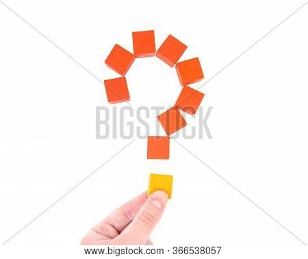 Female Hand Builds A Question Mark Out Of Wooden Blocks. Top View, Isolated On White. Comprehension