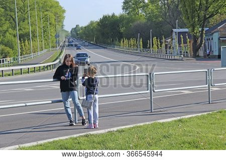 Chernihiv  / Ukraine - 10 May 2020 / Ukraine: Little Girls Take Pictures Of Each Other Near The High