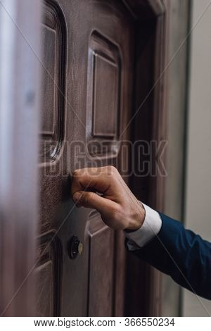 Partial View Of Collector Knocking On Door With Hand
