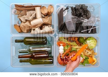 Four Transparent Containers With Trash On A Blue Background: Glass, Plastic, Organic Trash, Paper. A