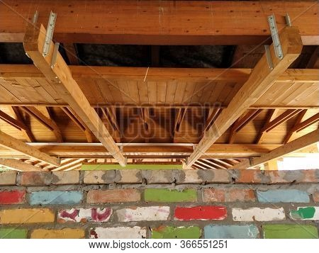 Wooden Construction - Roof Truss Made Of Beams. Rafters And Support Beams Made Of Fresh Wood. Downst