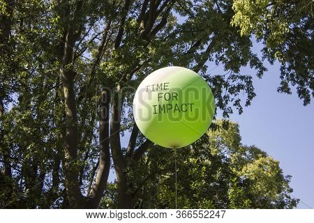 Green Balloon With Text Through Trees