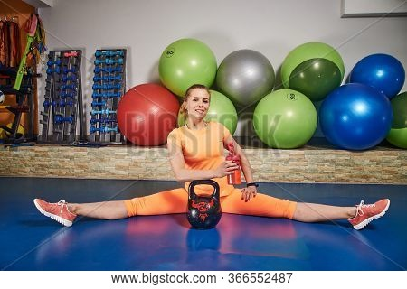 Slim Athletic Young Woman In Sportswear Does Exercises Using Weight In Fitness Club. Female Home Wor
